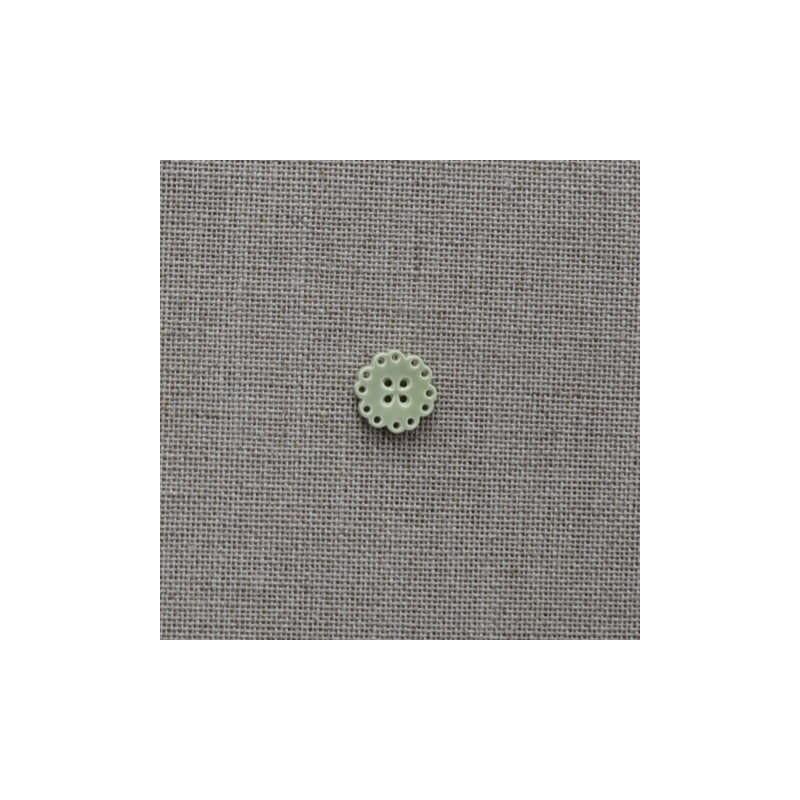 Bouton en plastique blanc façon os avec motif feuilles noires 20mm